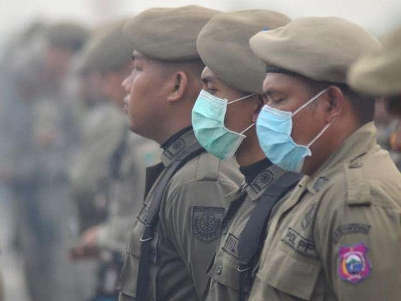 Dikepung Asap, Begini Suasana Upacara Satpol PP Se-Indonesia di Palembang