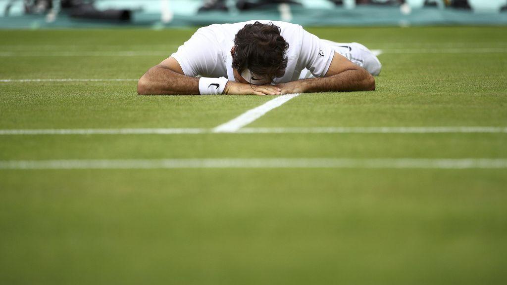 Federer Disingkirkan Raonic Usai Bertanding Lima Set