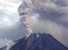Kepulan asap disertai letusan keluar dari puncak Gunung Sinabung.