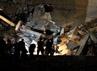 Gedung administrasi di kompleks Kadhafi ini hancur akibat serangan udara pasukan sekutu. AFP/Imed Lamloum.