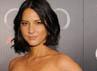 Bintang Date Night, Olivia Munn menduduki peringkat dua daftar Perempuan Terseksi Tahun 2011. Michael Buckner/Getty Images.