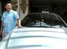 Ki Kusumo berpose dengan salah satu mobil mewah miliknya. Rengga Sancaya/detikcom