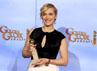 Kate terlihat bahagia dengan penghargaan tersebut. Reuters/Lucy Nicholson.