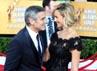 George Clooney tampak mesra dengan Stacy Keibler. Getty Images.