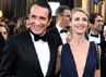 Jean Dujardin dan Alexandra Lamy berpose di red carpet. Getty Images.