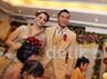 Kue tar pernikahan mereka yang amat besar dipotong sebagai tanda dimulainya pesta pernikahan kedua sejoli tersebut. Pastinya mereka juga ditemani oleh ketiga anak Okie.