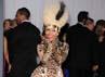 Nicki Minaj sepertinya sangat mencintai motif leopard. Ia membungkus tubuhnya from head to toe dengan motif leopard saat menghadiri acara The 53rd Annual GRAMMY Awards pada 13 Februari 2011. Jason Merritt/Getty Images.