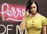 Katy Perry tampil simple dan seksi dengan dress hijau mudanya. Reuters/Ricardo Moraes.