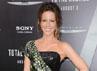 Dibalut gaun bermotif ular, Kate Beckinsale tampil anggun. Frazer Harrison/Getty Images.