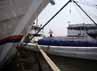Seorang pekerja membersihkan kapal yang digunakan sebagai alat transportasi penyebarangan barang di Pelabuhan Sunda Kelapa, Jakarta.
