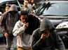 Para tersangka tiba di Mapolres Jakarta Selatan untuk menjalani rekonstruksi.