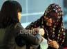 Seorang petugas KPK menyerahkan berkas kepada Sutiana Atika. Ramses/detikFoto.
