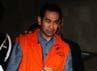 Tubagus Chaer Wardana alias Wawan keluar dengan mengenakan baju tahanan warna oranye.