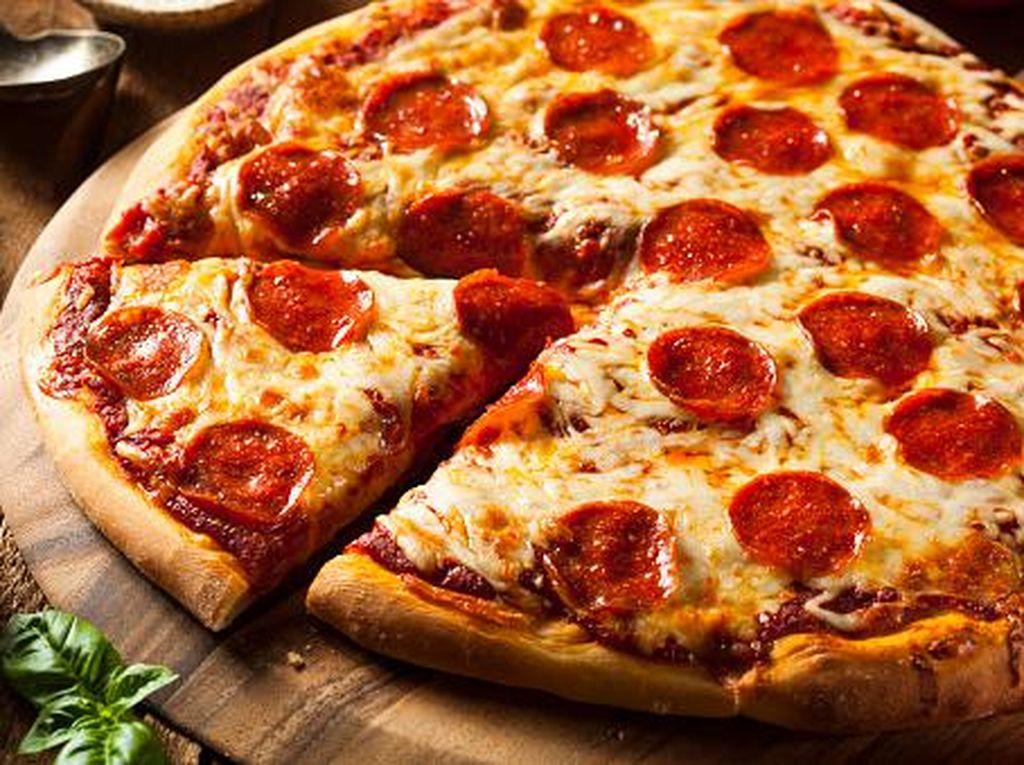 Cara Baru Pesan Pizza di Inggris, Cukup dengan Tempelkan Tato Temporer